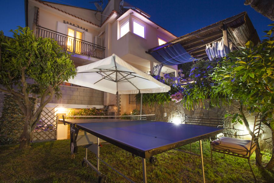 Garden by night with tennis table